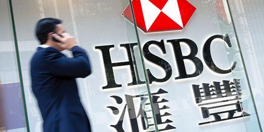 HSBC's profits slump 62% as private bank writes down £3.2bn